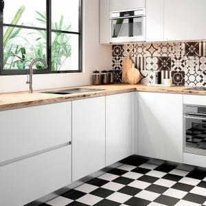 Kitchen renovation with Patchwork tile collection in assorted black & white patterns